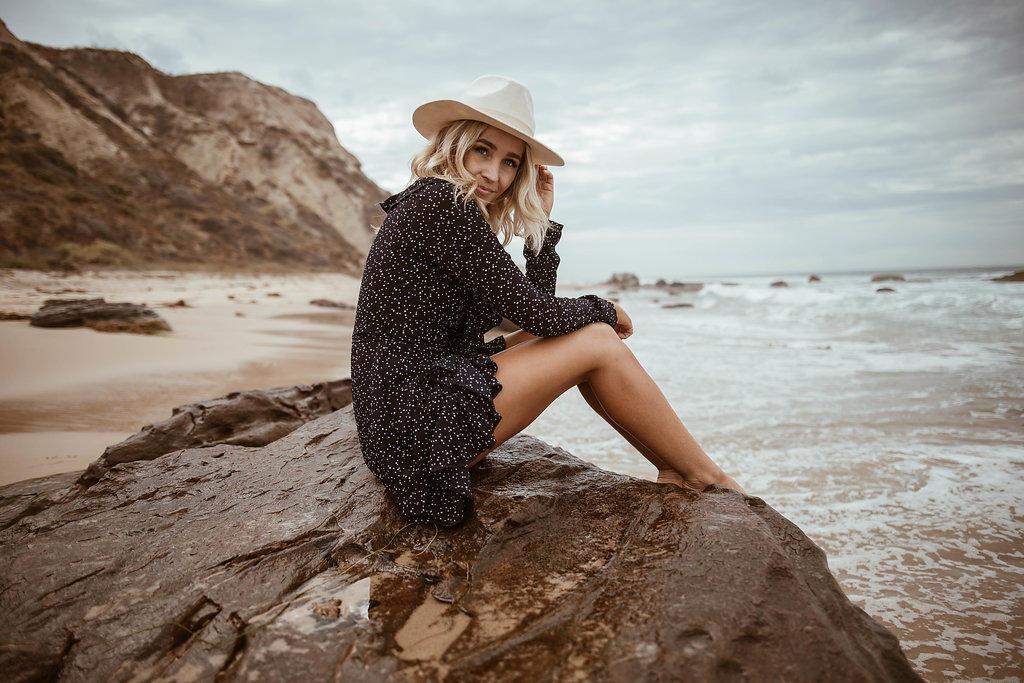 beach photoshoot in navy wrap dress