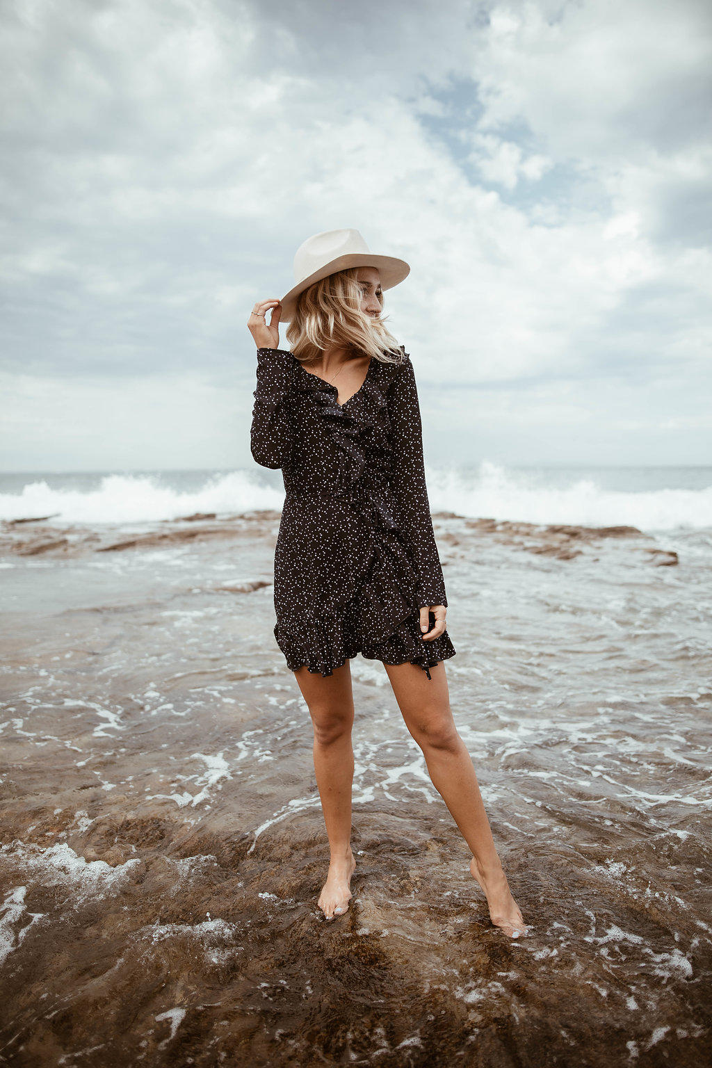 navy wrap dress at the beach